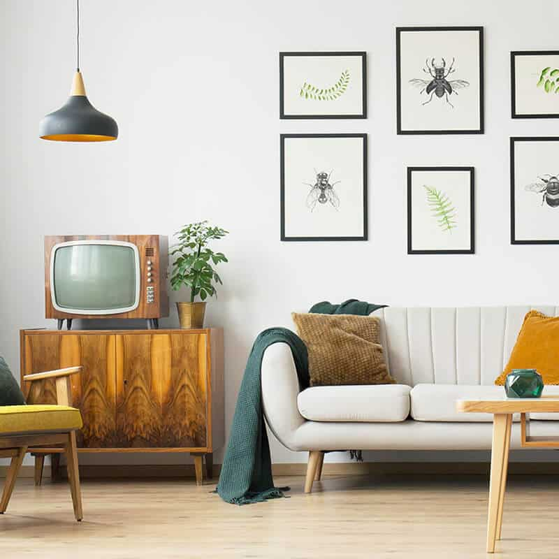 Living Room with sofa, tv, frames on the wall